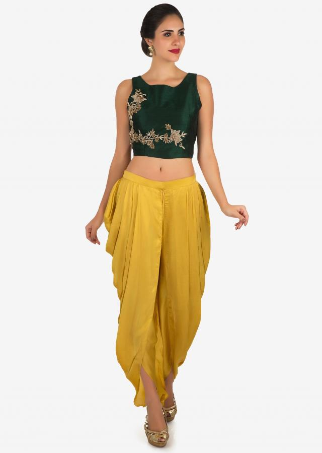 Dark green and yellow dhoti suit enhanced in zardosi embroidered work only on Kalki