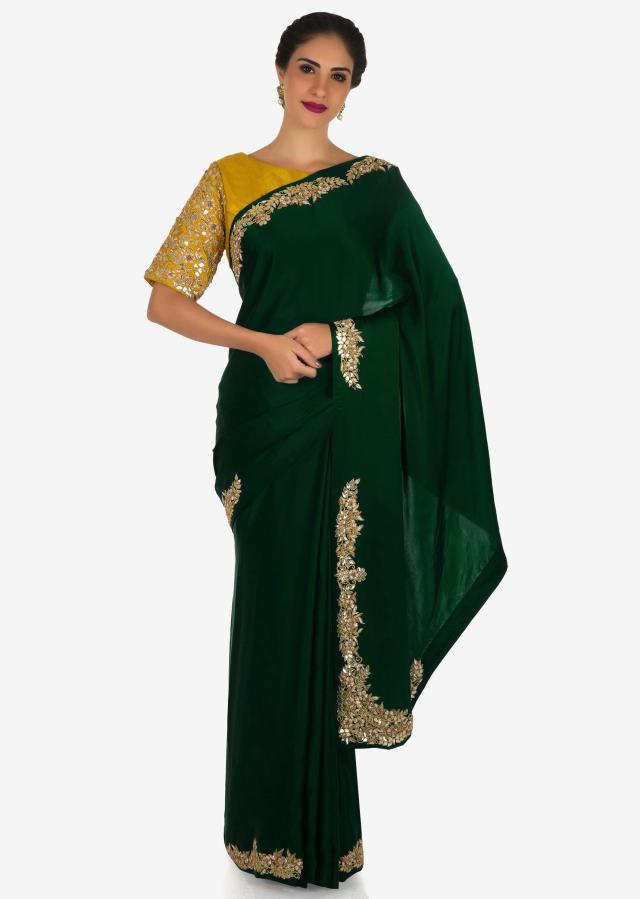 Dark green saree in satin silk adorn in beautiful gotapatti embroidery work only on Kalki