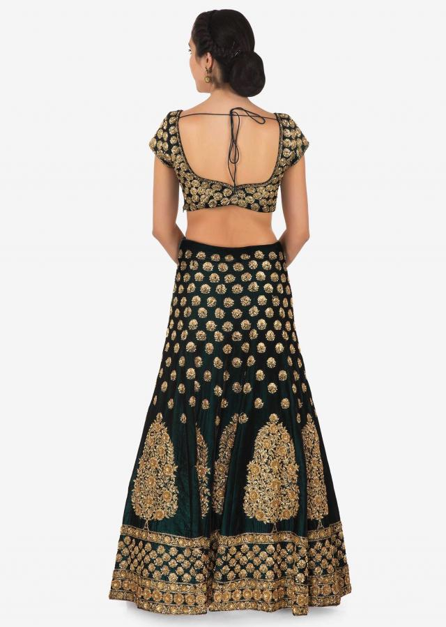 Dark olive green embroidered lehenga matched with contrast beige dupatta only on Kalki