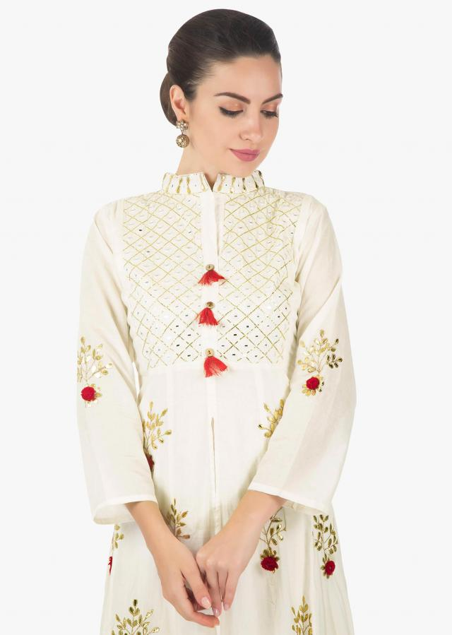 Double layer kurti in cream adorn in gotta patch and mirror work only on Kalki