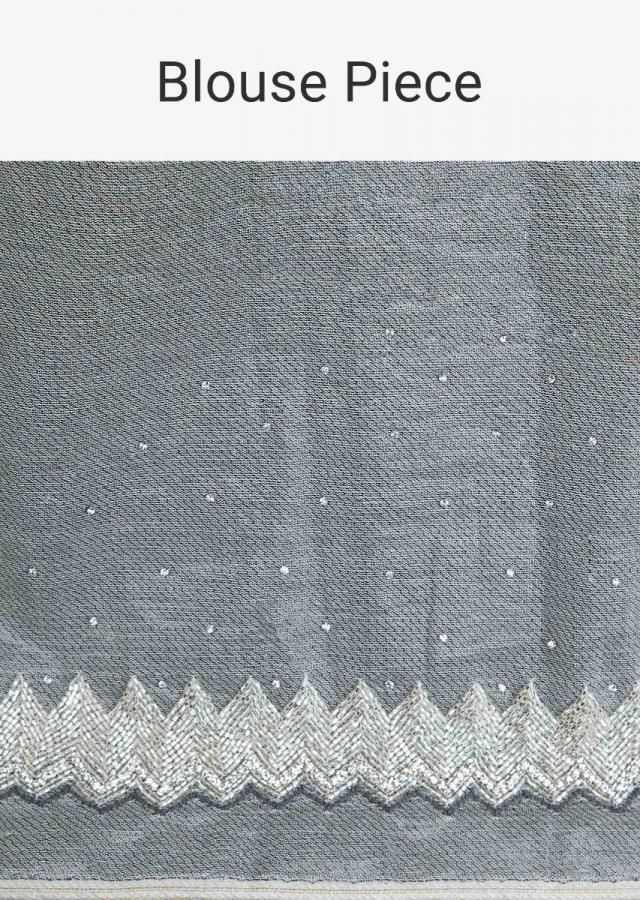 Dove grey hard net saree in floral jaal embroidery only on Kalki