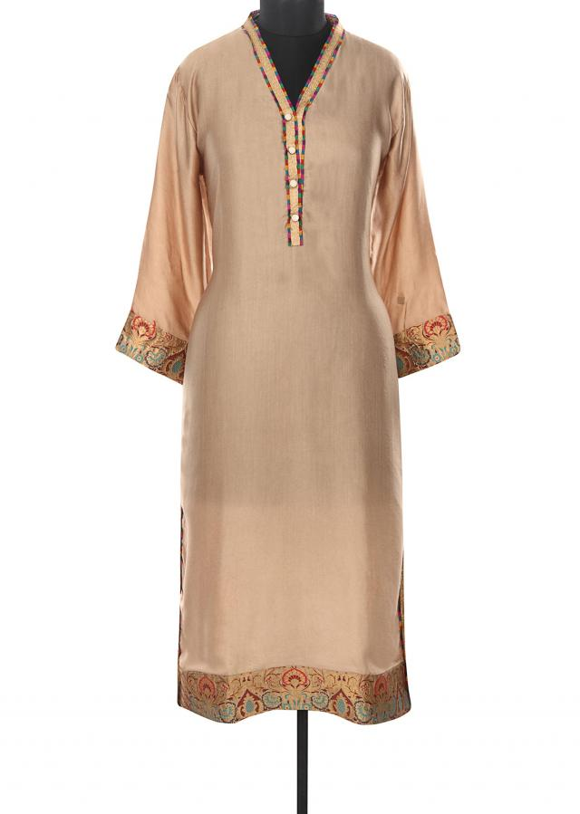 Dull gold kurti enahcned in brocade cuffs only on Kalki