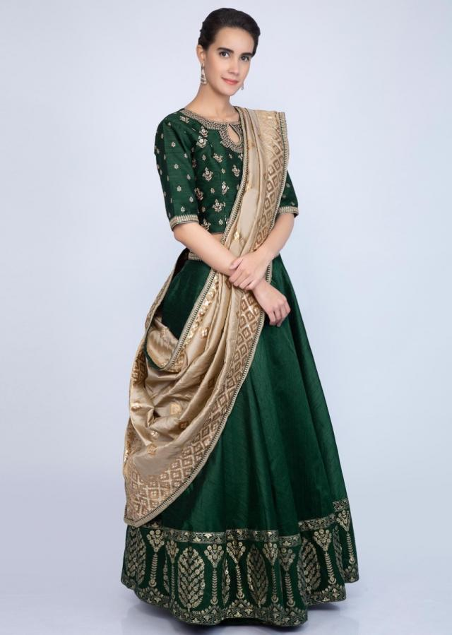 Emerald green raw silk embroidered lehenga set contrasting brocade dupatta only on Kalki