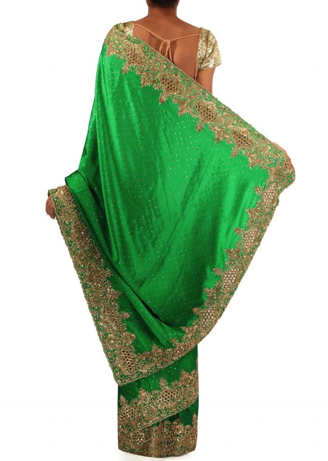 Emerald green saree featuring in cut work border only on Kalki
