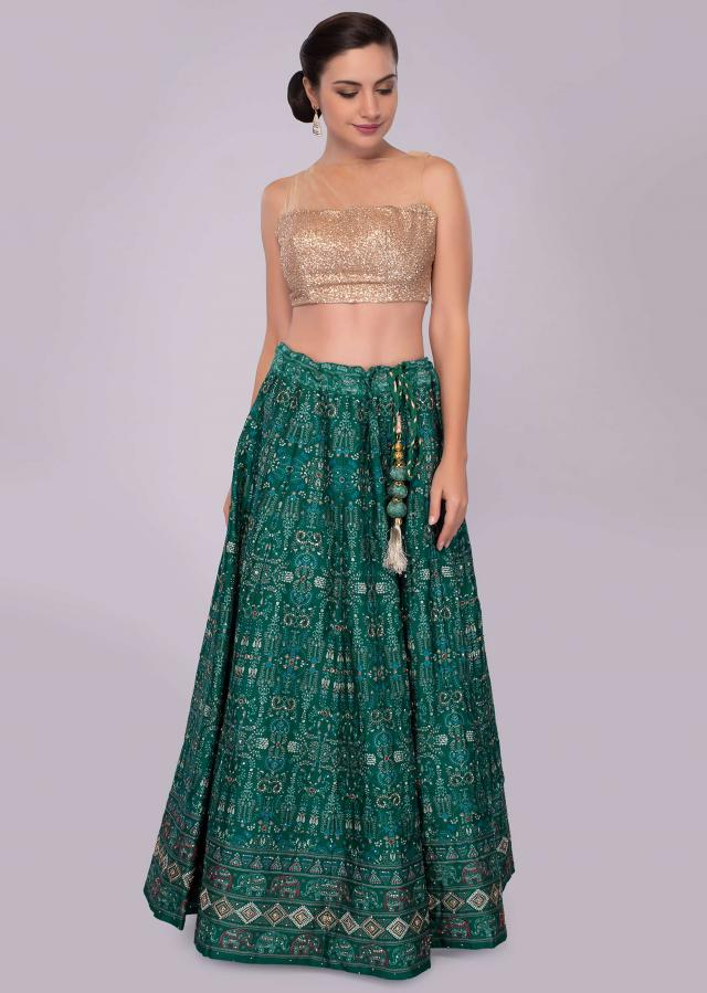 Emerald green silk lehenga with patola print and embroidery only on Kalki
