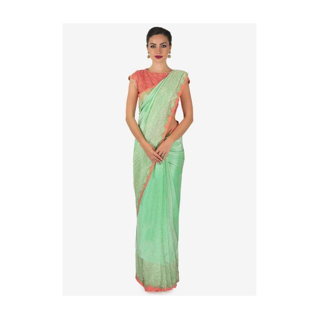 Equisite amalgamation of  sea green silk saree and peach silk blouse exclusively on kalki