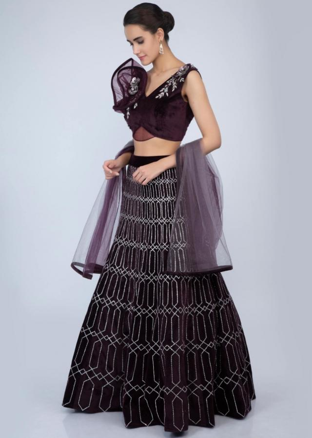 Fancy velvet blouse with ruffled panel sleeves paired with shaded plum velvet lehenga only on Kalki