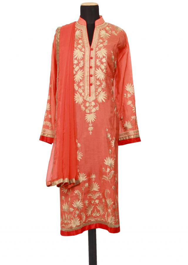Featuring a coral cotton silk straight fit semi stitched salwar kameez embellished in zari only on Kalki