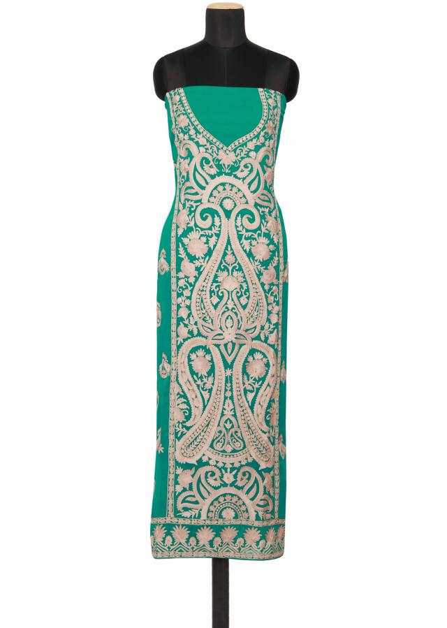 Featuring a green georgette unstitched salwar kameez embellished in beige thread work and gold kundan work only on Kalki