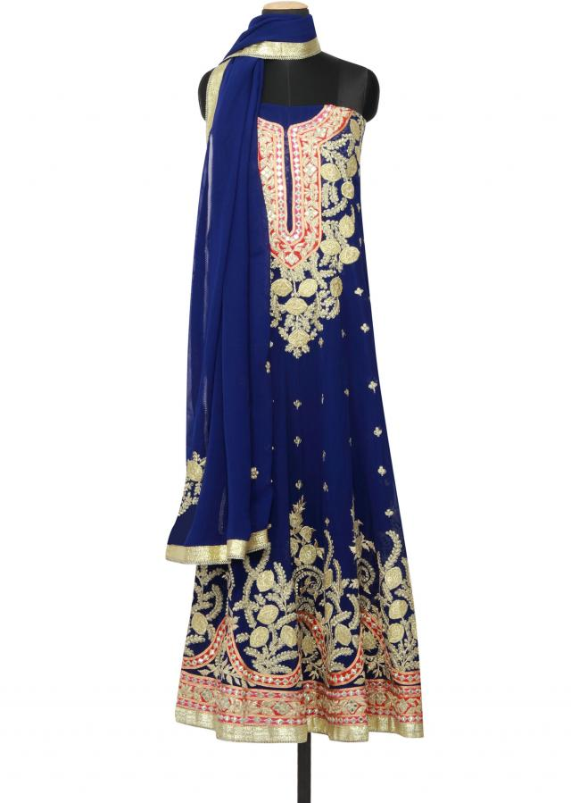 Featuring a navy blue semi stitched georgette anarkali  embellished in gotta patti, mirror and zari work only on Kalki