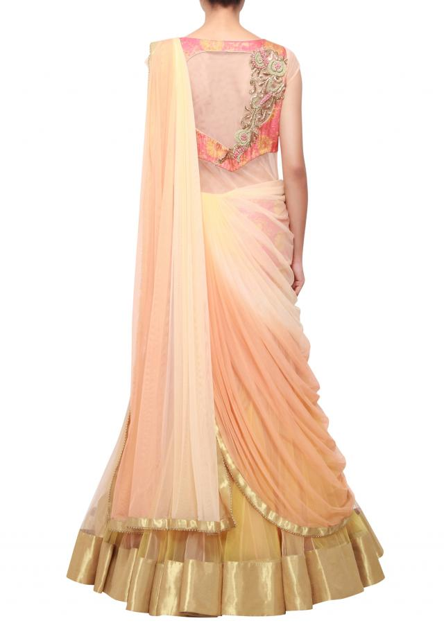 Peachy cream shaded lehenga sari embellished in zardosi only on Kalki