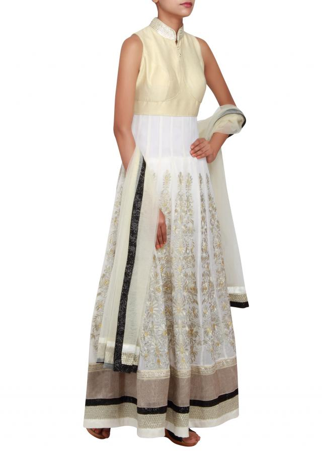 Featuring a off-white georgette anarkali embellished in zari and sequence only on Kalki
