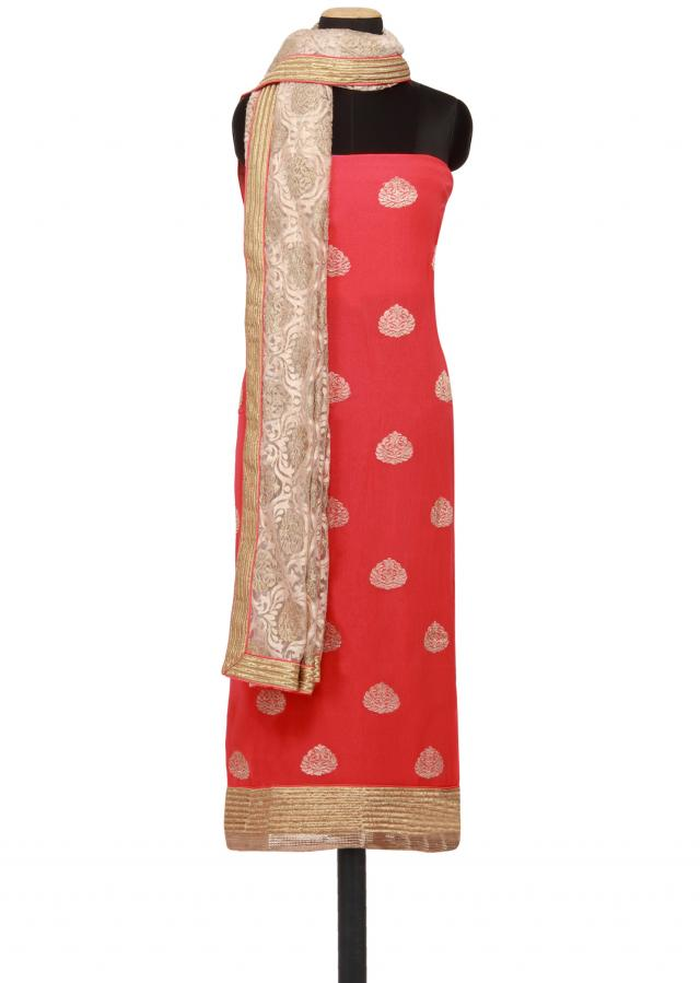 Featuring a peach georgette unstitched salwar kameez embellished in gold zari embroidery only on Kalki