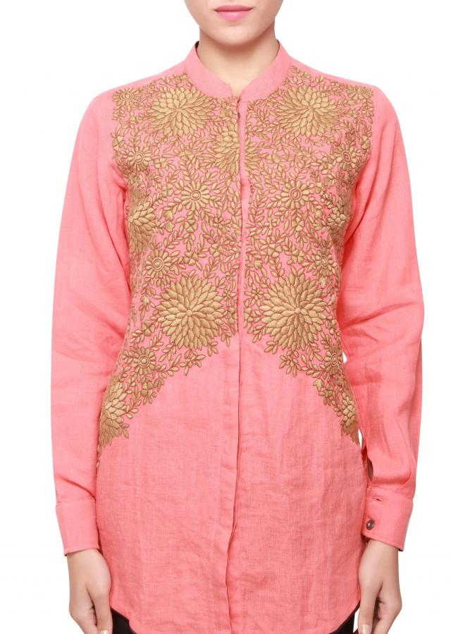 Featuring a peach short cotton kurti with gold embellishment only on kalki