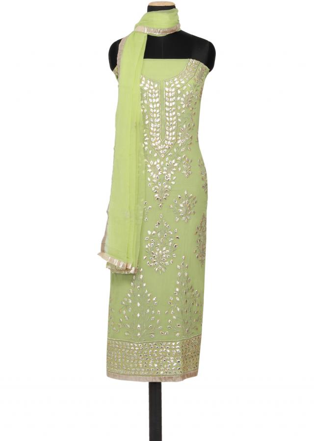 Featuring a pistachio green georgette unstitched salwar kameez embellished in gotta patti only on Kalki