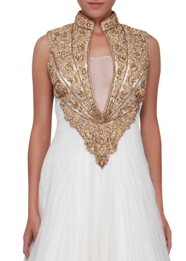 Featuring a snow white gown in embellished in gold stone embroider  only on Kalki