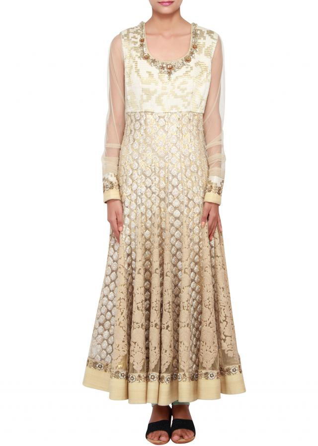 Featuring beige anarkali in net embellished zari and zardosi work only on Kalki