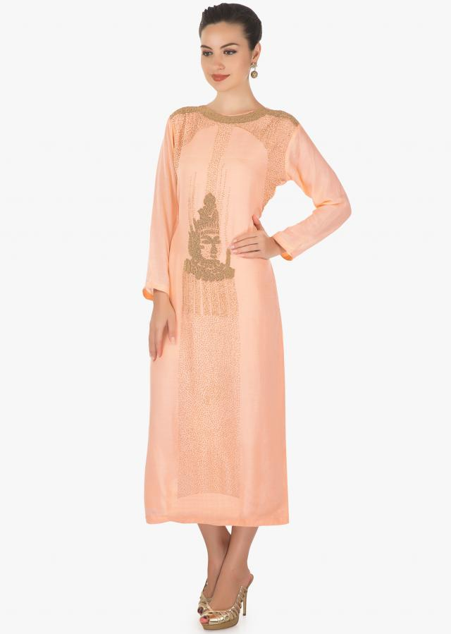 Featuring light peach cotton kurti in moti  face motif only on kalki