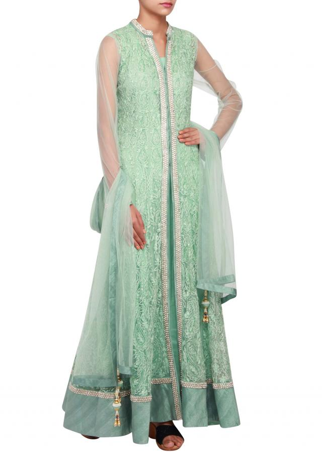 Featuring mint anarkali in net embellished in thread work and stone only on Kalki