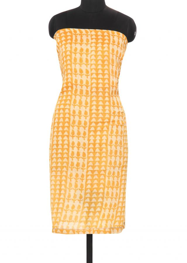 Featuring mustard and cream unstitched printed suit only on Kalki