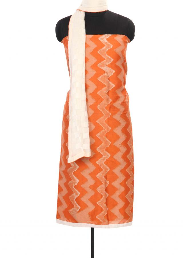 Featuring orange and cream unstitched printed suit only on Kalki