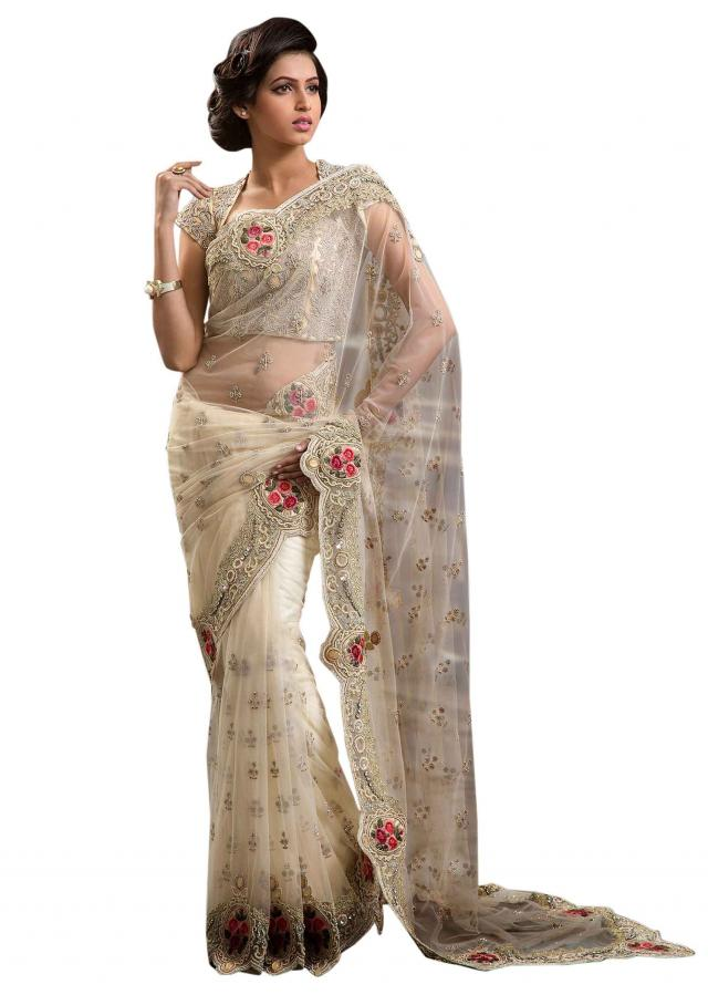 Featuring white embellished saree in kundan and resham only on Kalki