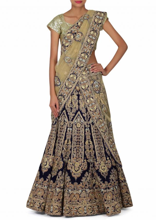 Featuring semi stitched lehenga in blue with kundan work only on Kalki