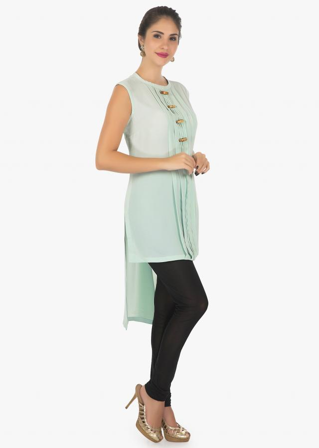 Fern Green kurti featuring in georgette with fancy buttons and pleats only on kalki
