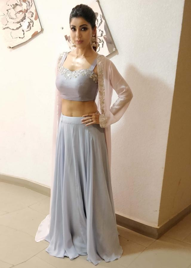 Debina Bonerjee in Kalki flint blue skirt and crop top matched with a contrasting powder pink long jacket