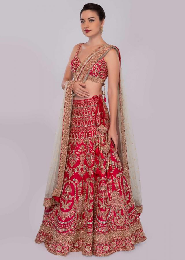 Fuchsia  pink embroidered raw silk lehenga set  with mint green  net dupatta only on Kalki