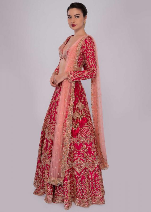 Fuchsia pink raw silk lehenga set in temple and floral embroidery only on Kalki