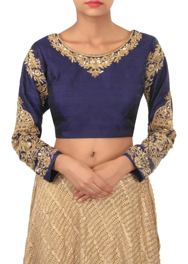 Gold fancy lehenga with navy blue crop top only on Kalki