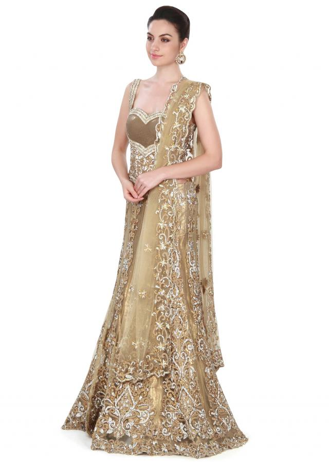 Gold lehenga adorn in kundan and stone embroidery only on Kalki