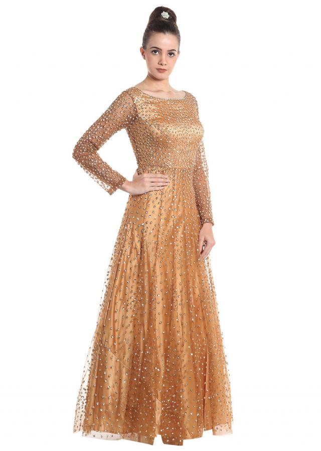 Gold shimmering net gown only on Kalki