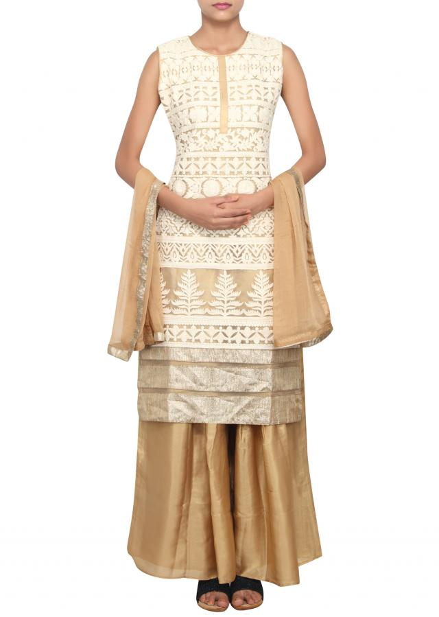 Gold straight fit suit featured in net embellished with white thread work only on Kalki
