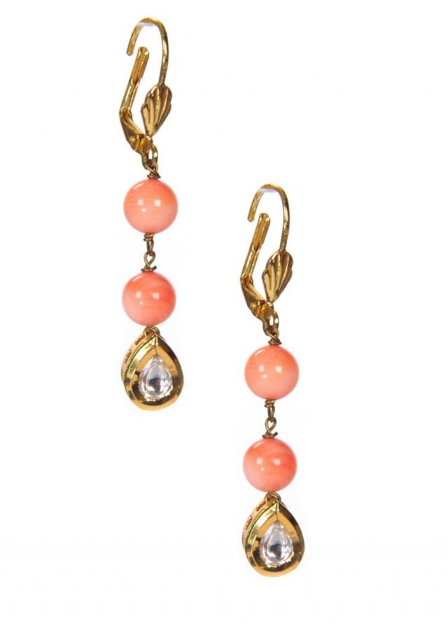Gold Earrings Embellished in Peach Pearls only on Kalki