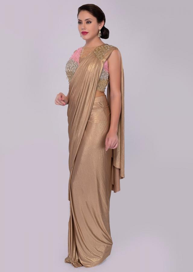 Golden wrap around shimmer lycra saree with multi color sequins net blouse only on kalki