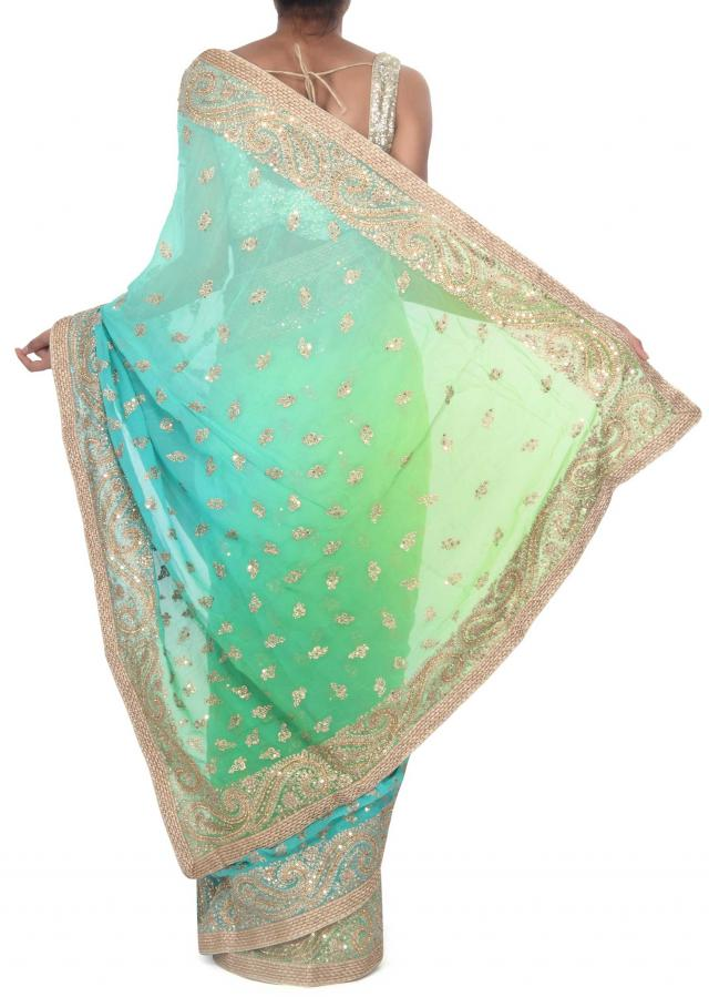 Green and turq shaded saree adorn in paisley motif embroidery only on Kalki