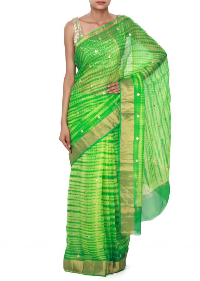 Green batik saree enhanced in gotta patch work only on Kalki