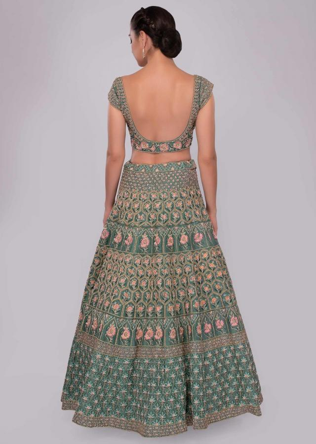 Green raw silk lehenga set in temple and geometric embroidery only on Kalki