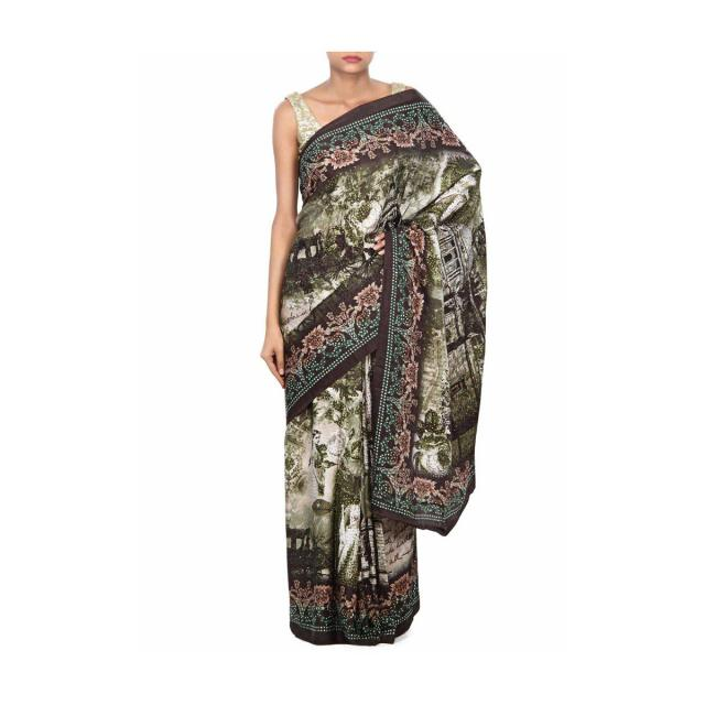 Mossy green saree enhanced in floral print only on Kalki