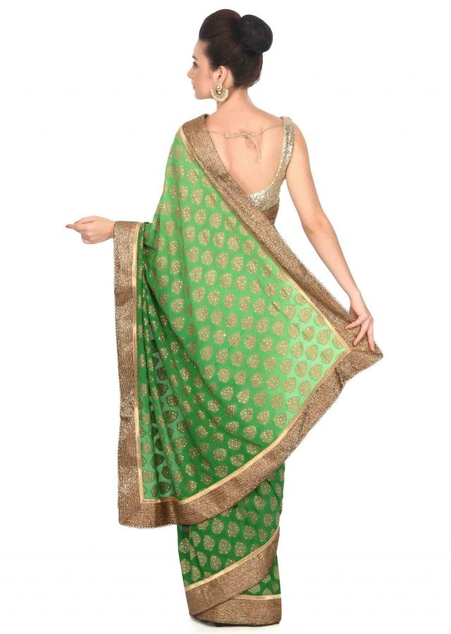 Leaf green saree enhanced in kundan and kardana embroidery only on Kalki