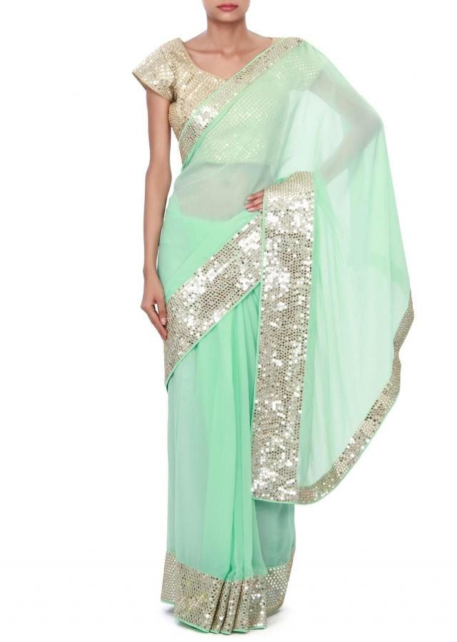 Green saree enhanced in sequin border only on Kalki