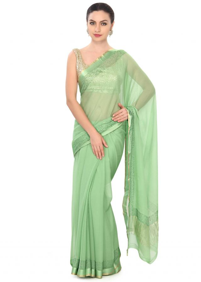 Green saree highlighted in kundan border only on Kalki