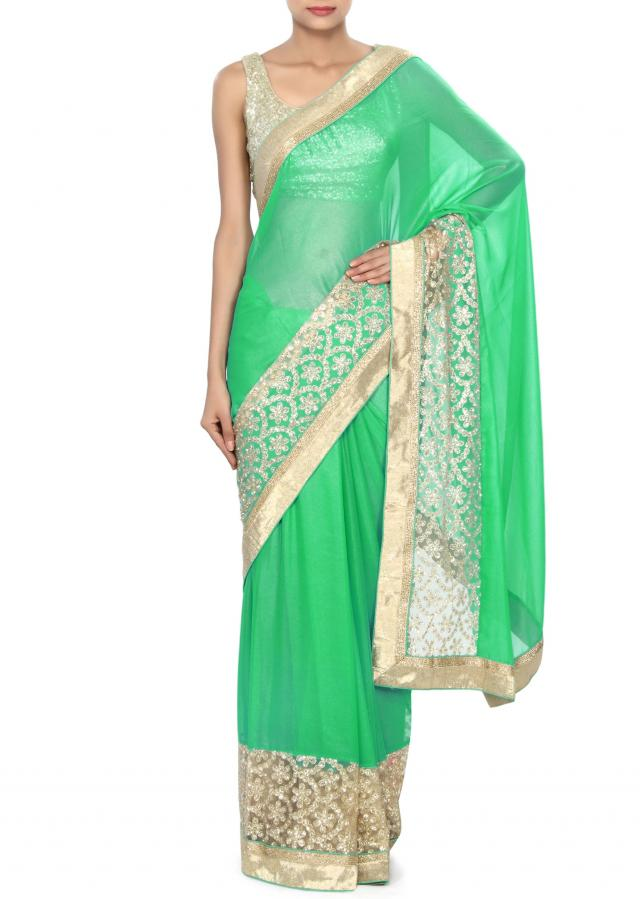 Green shimmer saree embellished in sequin embroidery only on Kalki