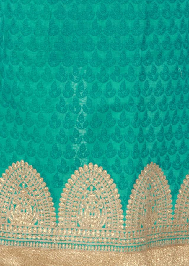 Green unstitched suit adorn in thread work only on Kalki