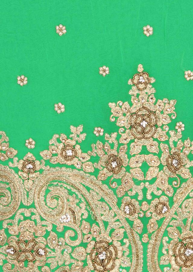 Green unstitched suit adorn in zari and kundan embroidery only on Kalki