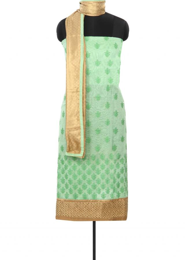 Green unstitched suit enhanced in resham embroidered butti only on Kalki
