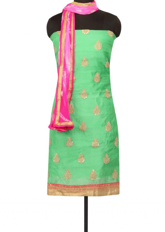 Green unstitched suit resham and zari butti only on Kalki