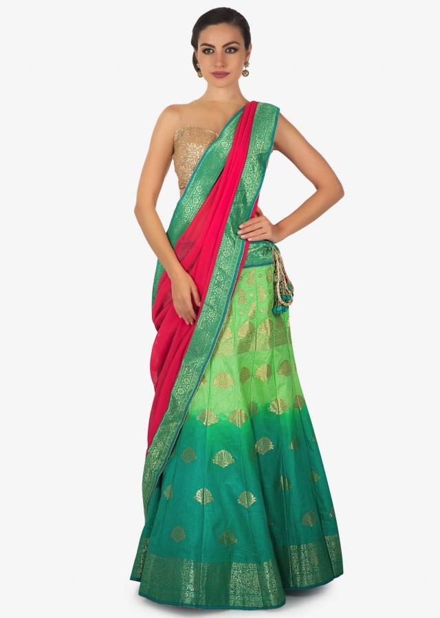 Green and turq shaded lehenga matched with contrast pink dupatta only on Kalki